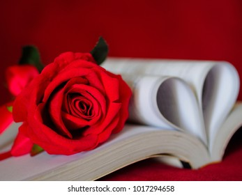 Retro style for red rose with  pages of a book curved into a heart shape. Love and Valentine's day concept.