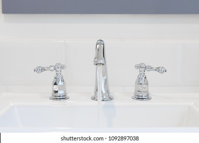 Retro style tap at washbasin pouring water