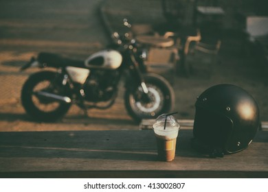 Retro style of vintage helmet with motorcycle in background