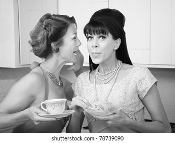 Retro styled Caucasian woman shares a secret with her friend