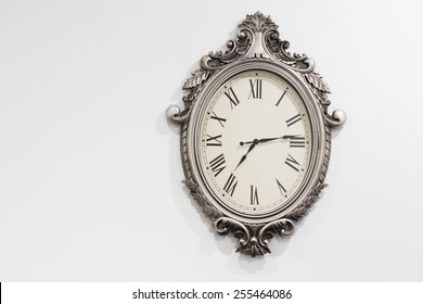 Retro styled clock on white wall