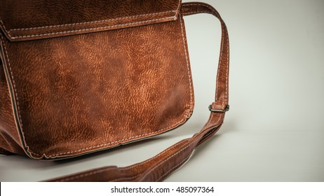 Retro styled or retro color minimalist and luxurious brown leather feminine fashion hand bag or sling bag. Slightly de-focused and close-up shot. Copy space.