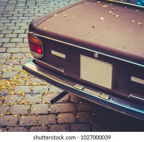 Retro Styled Detail Of A Brown 1970s Car On A European Cobblestone Street