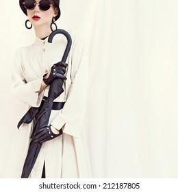 7defdaff2c19 Retro styled fashion girl with umbrella glamorous portrait