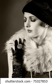 Retro styled fashion portrait of a young woman in gloves. Clothing and make-up in vintage style
