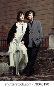 Retro styled fashion portrait of a young couple. Clothing and make-up in 1920s style.