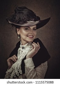 Retro Styled female portrait with vintage makeup and dress