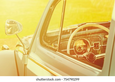 Retro styled image of the interior of a green classic car