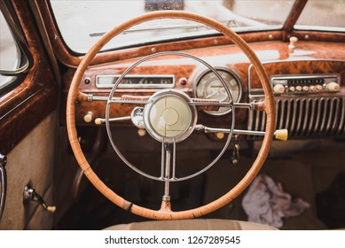Retro styled image of an old car radio inside  classic car