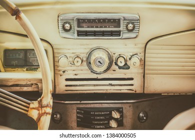 Retro styled image of an old dashboard inside a classic car