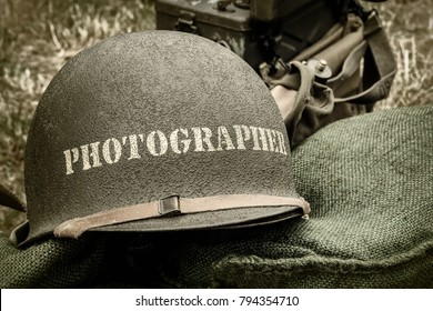 Retro styled image of an old helmet of a war photographer