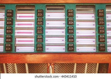 Retro styled image of an old jukebox with blank music labels
