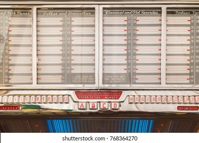Retro styled image of an old jukebox with empty music labels