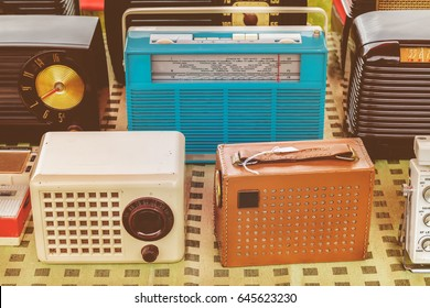 Retro styled image of old radio's for sale on a flee market