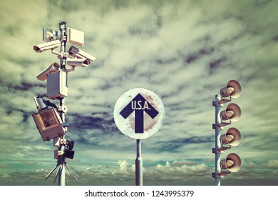 Retro styled image of surveillance cameras with vintage USA direction sign