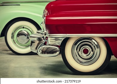 retro styled image of two vintage American cars parked next to each other