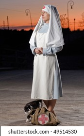 Retro styled nurse with cat and first aid kit at sunset