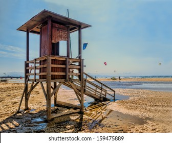 retro styled photo of an abandoned lifeguard tower on the beach of tarifa, andalusia in autumn