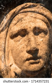Retro styled sad eyes view of Virgin Mary. Vintage stone statue of woman in grief