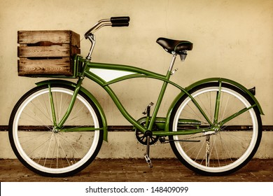 Retro styled sepia image of a vintage beach cruiser bicycle with wooden crate