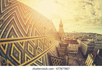 Retro stylized fisheye lens picture of Vienna at sunset, view from the north tower of St. Stephen's Cathedral, Austria.