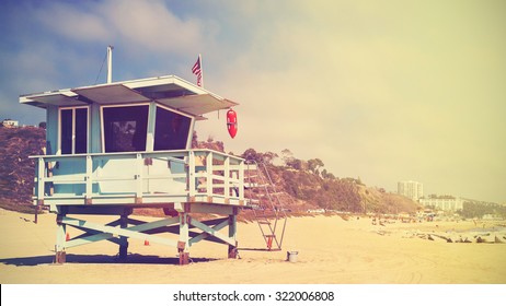 Retro stylized panoramic picture of a lifeguard tower in Santa Monica at sunset, California, USA.