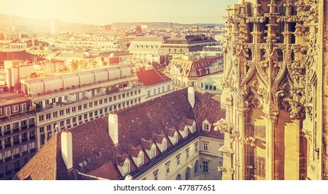Retro stylized picture of Vienna St. Stephen's Cathedral tower details at sunset, view from the north tower of Austria.