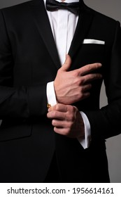 Retro suit fashion. Formal classic suit. Business style outfit. Handsome businessman adjusting his sleeves.