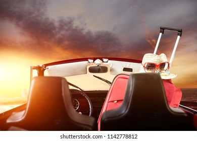 Retro summer car with suitcase and golden sunset time of mood color. Free space for your decoration.