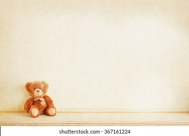 Retro Teddy Bear toy alone on wooden floor