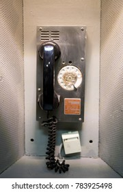 Retro telephone in a metal booth