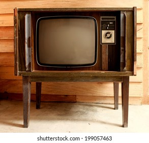 Retro television in cover wood in front wall.