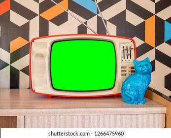 Retro television mock up with vintage wallpaper in the background. Template interior decoration with ceramic decoration from the 70s