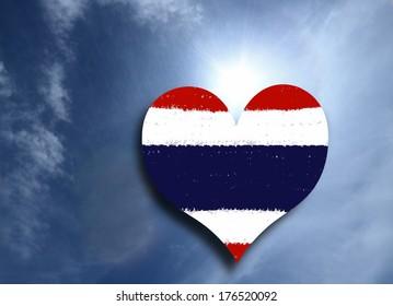 Retro Thai flag heart shape on blue sky background