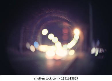 Retro toned blurred street lights, urban abstract background with harsh vignette, copyspace