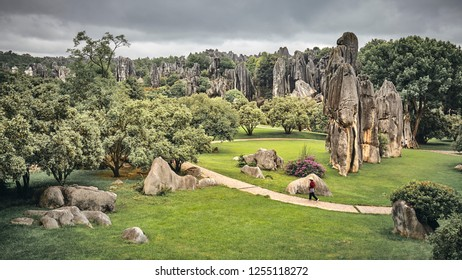 Retro toned panoramic view of the Stone Forest (Shilin). Two sections of the scenic area belong to UNESCO World Heritage Sites as part of the South China Karst, Yunnan, China.