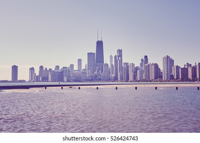 Retro toned photo of Chicago city downtown skyline, USA.