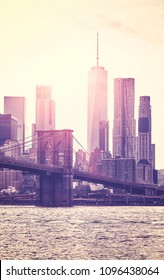 Retro toned picture of Manhattan skyline at sunset, New York City, USA.