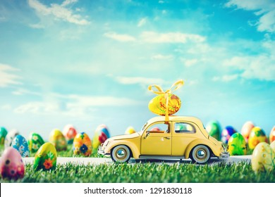 Retro toy car with Easter egg on the roof in fairytale spring scenery. Hand painted eggs. The car is brandless - reshaped and modified.