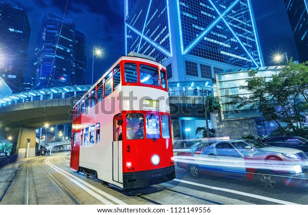 Retro tram on the evening city street. Hong Kong.