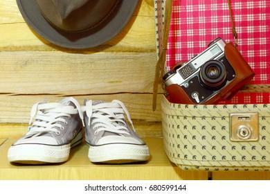 Retro travel accessories.Suitcase,camera,sneakers,hat