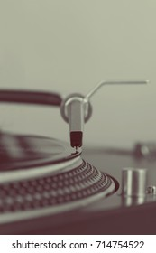 retro turntable in closeup ready to play those old vinyl music records