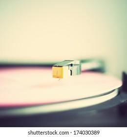 Retro turntable with pink vinyl