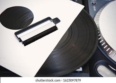 Retro turntables and static cleaning brush in sound recording studio.Professional dj turn table player device & vinyl records with classic music.Listen to classic musical tracks in hiqhest quality
