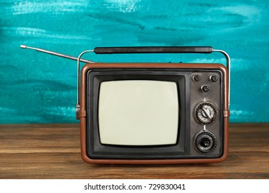 Retro TV on color background
