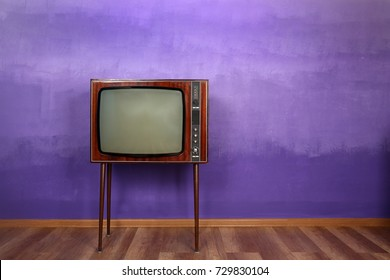 Retro TV on color wall background