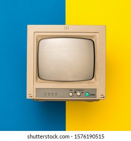 Retro TV on yellow and blue background. The view from the top. Vintage electronics.