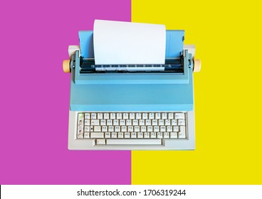 Retro typewriter placed on multi coloured table. Aerial angle of view.