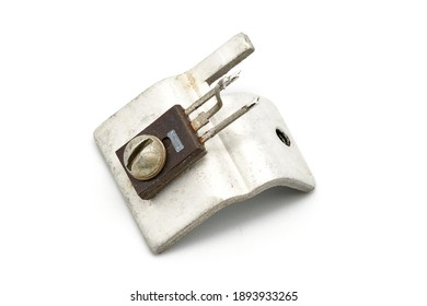 retro used transistor assembly with cooling heatsink. isolated on white base