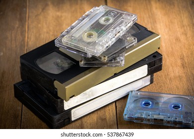 retro video tape and  cassette tape on wood